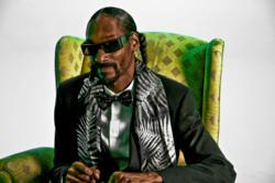 Snoop Dogg reclines in a chair at Loyal Studios, Santa Monica