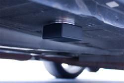 SleuthGear iTrail GPS Logger magnetically attached under a vehicle.