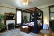 King Canopy Bed, Whirlpool for Two, and Fireplace