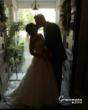 Bride and groom kiss in the entry of The Beall Mansion