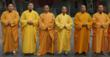 Shaolin Grand Master Shi DeYang &amp; Shi DeRu with Figitng Monks  at the Shaolin Temple Gate