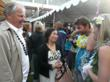 Ernie Henken and Gina Olan talk with winner Diana