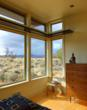 Oversized master bedroom windows framing red rock views to the North