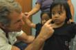 Mel Gibson visits with children during a Mending Kids International surgical mission.  The three-year old twins pictured were part of a neuro clinic held at a Guatemala City hospital.   Mending Kids I