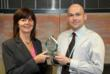 Simon Angelo accepting SpeechSchool.TV's Country Winner trophy in the recent Technium Challenge International from Lesley Griffiths, Deputy Minister of Science & Innovation, Welsh Assembly Government.