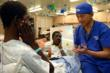 Dr. Leo Cheng gives therapy instruction to Harding in the ward after surgery.