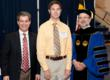 Scholarship recipient Jonathan Barkley is flanked by Alan Kleban, Vice President at KBE Building Corporation on his right and Joseph Urgo, President of St. Mary's College on his left.