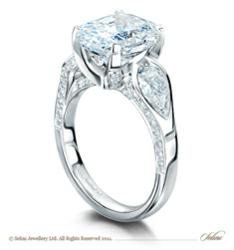 An exceptional 5 carat radiant cut diamond flanked by 2 pear cut diamonds set in a complex platinum pavé set mount.