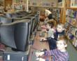 children in front of computers in the school media center