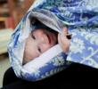 Baby rests comfortably on attached breastfeeding cover, while also making it easy for mothers to support baby while breastfeeding.