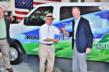 Jack Roush, founder of ROUSH CleanTech hands Paul Grady, president of Heritage Propane L.P. the keys to a ROUSH CleanTech propane autogas Ford E-Series passenger van.