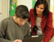 teacher and student at computer