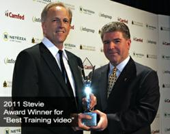 Todd R. Corbett recieves Stevie award