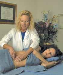 Belinda Wurn, PT, treats a patient for infertility using the Wurn Technique, a hands-on physical therapy.