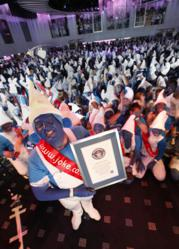 A smurf from Jokers' Masquerade Fancy Dress receiving the Guinness World Record certificate.