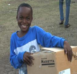 Haitian Child Holding Marietta Soap Donation