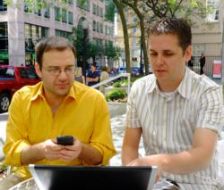 Digital Journal's David Silverberg (left) and Chris Hogg discuss the company's Global Editorial Meetings.