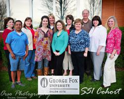 The first graduating class of George Fox University's elementary education adult degree program gather at the June 22 celebration event.