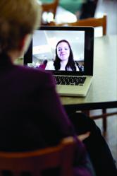 Dr. Carol Austin, professor of education at Missouri Baptist University, chats with a student via Skype about online academic programs.