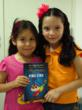 "Children with their copies of ""The Way to Happiness Presented by Cri Cri."""