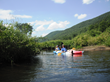 Kayaking down a local river in Killington, Vt