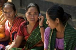 Women who are part of BRAC's microfinance program, like the one featured above, will now be able to access financial services through their mobile phone