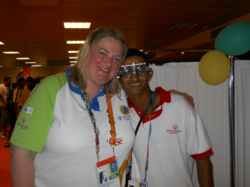 Dr. Kellye Knueppel of The Vision Therapy Center poses with a Special Olympics athlete.