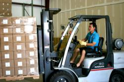 Owner of Peachwave moves pallet with forklift