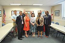 TCM representative with Tuscaloosa administrators