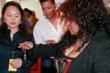 Chaka Khan holding a harmonica necklace