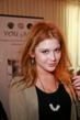 Renee Olstead wearing stainless steel knife earrings