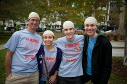 A team of students from Boston, MA wear bald caps to honor cancer patients and raise money to fight the disease