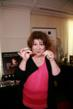 Margo Martindale holding a harmonica necklace