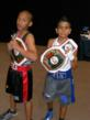 Nevada champions Jojit Butay-Fillon, Jr. (9-10 95 Pounds),  left, and Rey Daniel Diaz  (11-12, 75 Pounds) proudly display their belts after taking prestigious victories in the annual Junior Golden Glo