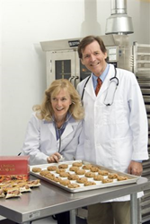 The co-founders of the Omega3 Innovation, Drs Anne-Marie Chalmers and Bo Martinsen, pose with their patented Omega Cookie.