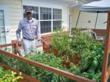 Burgess checking his plants