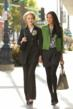 Two women walking Ponte Trench and CAbi Blouse