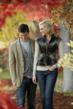 Couple walking in the park wearing CAbi fall items