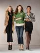 Three friends wearing CAbi Fall Collection items
