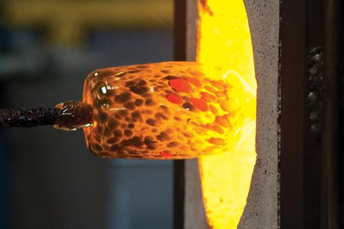 Blowing glass glory hole