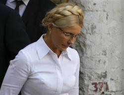 Yulia Tymoshenko, Former Prime Minister of Ukraine is arrested, hand-cuffed, and taken to prison