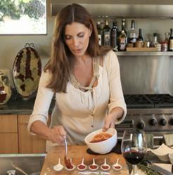 Lizanne Falsetto preparing gluten-free turkey meatballs in healthy snack video on Diet.com.