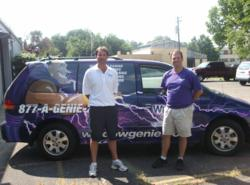 Ben Francis (left) from Window Genie window cleaning of Savannah, Georgia, and his technician Andy, display his eye-catching Geniemobile
