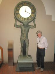 Larry Snyder, the founder of Canterbury International, stands with a clock he designed exclusively for famous jewelers Tiffany & Company.