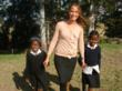 Angela Larkan, founder of Thanda.org, with two friends and participants in the Thanda After-School Program