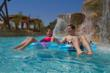 Couple on lazy river at Gaylord Texan's Paradise Springs