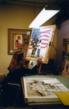 "Pomm painting ""Unspoken Courage"" in her Glendale studio"