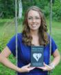 """Melissa Eshleman holding her book """"Always Within; Grieving the Loss of Your Infant""""."""