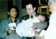 Ron and Dan holding David at his baptism in 1998 at St. Victor's Catholic Church in West Hollywood, CA