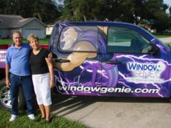 Steve and Judy Frommeyer, Window Genie Window Cleaning Clermont, Florida, stand next to an eye-catching Geniemobile
